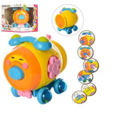 Ігра 8007 (12шт) свинка-бочонок,муз-звук(англ),світло,трещот,колеса-погремуш,на бат,в кор,27-24-24см